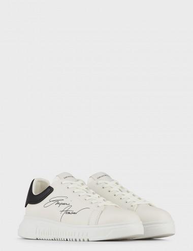 Sneakers in pelle con logo...